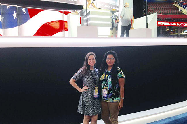 USF senior Mariana Sánchez Ramírez (right) and Temple University student Natasha Juliet Tax stand in front of the stage for the Republican National Convention in the Quicken Loans Arena in Cleveland in July.