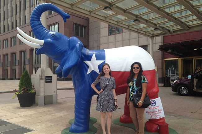 Ramírez and Tax in front of an elephant decorated for the RNC in downtown Cleveland.