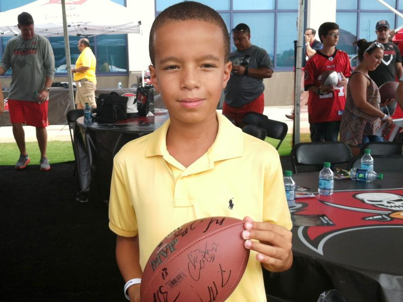 Tinker Elementary student Tyrell Downs, whose dad is stationed at MacDill Air Force Base, got several Buccaneer players to sign his football.get his football signed.