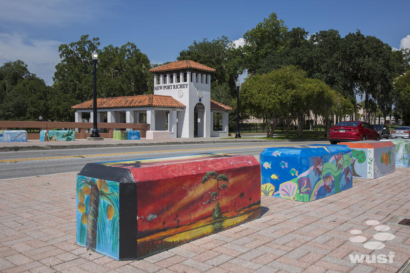 Several benches lining the Cotee River bridge In New Port Richey are painted by local artists.