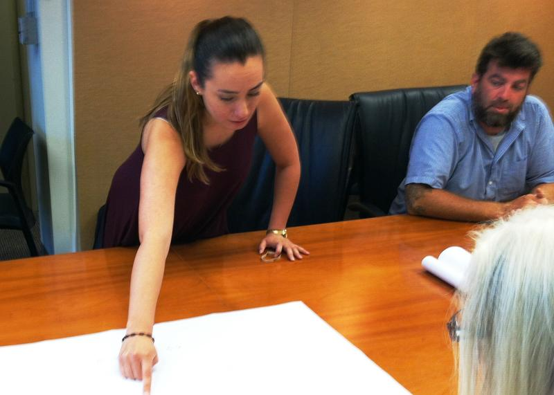 USF architectural student Yesenia Vega points out details in her design as class co-instructor Mike LeMieux looks on.