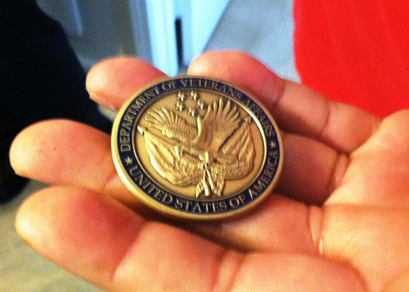Bernie Godette holds a coin given to him by VA Sec. Bob McDonald. Passing out challenge coins is a military tradition.