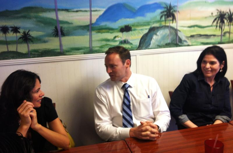 Patrick Murphy talks with supporters at the Arco Iris restaurant in West Tampa Monday