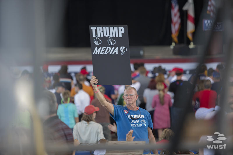 A Donald Trump supporter shows his feelings toward the media at an Oct. 24, 2016 rally in Tampa.