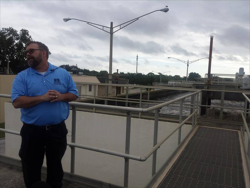 Craven Askew giving a tour of St. Petersburg's northeast sewage plant.