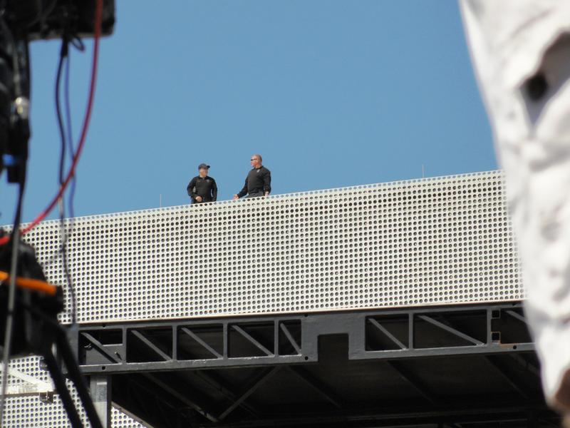Secret Service agents patrol on top of the Tampa Museum of Art