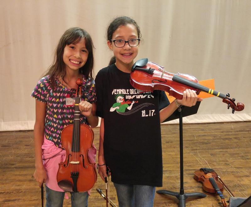 "6th graders Alexa Marroquin and Ivy Lopez of Seminole Middle School participated in the recent ""Electrify Your Strings"" program."