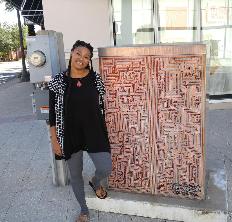 "Artist Ya La'Ford and her signal box, ""Golden cross-sections."""