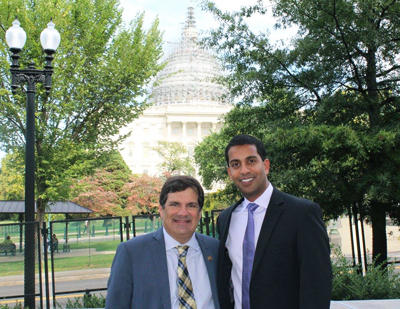 U.S. Rep. Gus Bilirakis, R-Fla., and Dr. Zack Kalarickal, stand outside the U.S. Capitol building. The two men teamed up to provide dental care to former military .