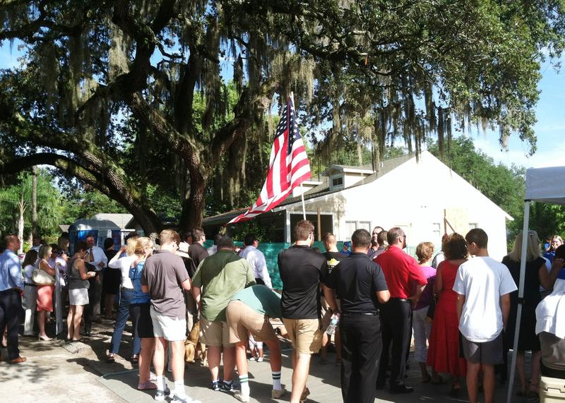 """Around 50 adults and children came out for the ceremonial """"wall raising"""" at the future home of combat veteran Justin Lansford sponsored by the Gramatica Family Foundation and people of Tampa."""
