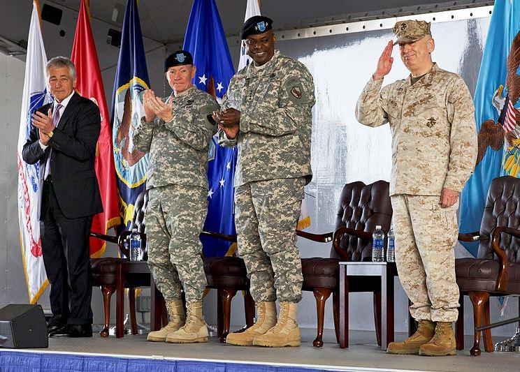 From left, Secretary of Defense Chuck Hagel, Chairman of the Joint Chiefs of Staff U.S. Army Gen. Martin E. Dempsey and Army Gen. Lloyd J. Austin III applaud in recognition of Marine Corps Gen. James N. Mattis during the CENTCOM ceremony March 22, 2013.