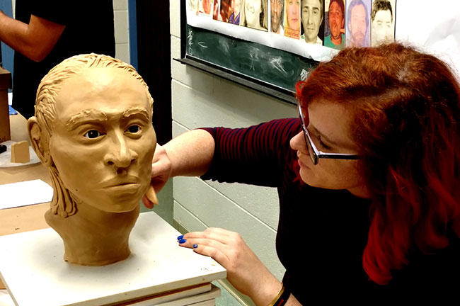 During the 'Art of Forensics' workshop at USF, freelance forensic artist Maggie Florence works on the likeness of a Hispanic man, believed to be 18-25, whose body was found in a grocery store in Frostproof in January 1993.