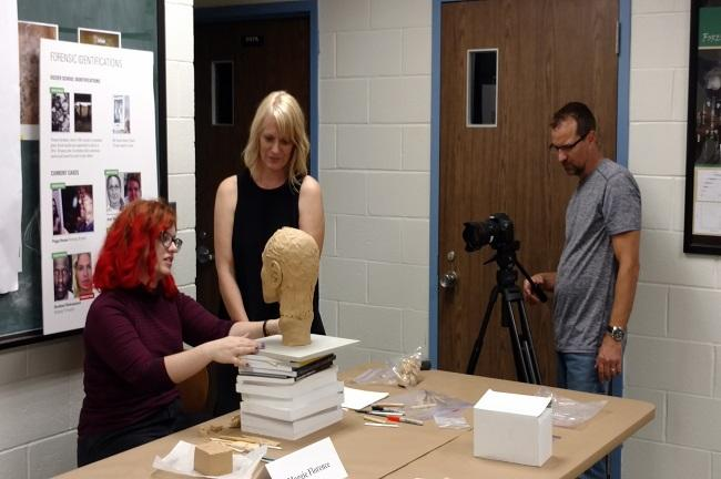 University Beat TV's Jesse McLane (right) shoots video of Florence & WUSF forensic anthropologist Erin Kimmerle.