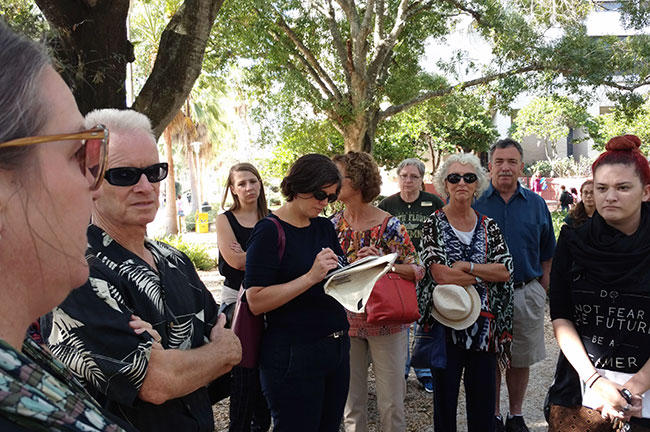 Sarah Howard (far left) from the USF Institute for Research in Art leads a recent walking tour looking at some of USF's public art.