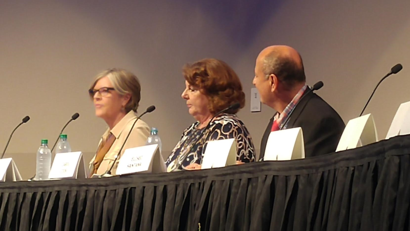 Carol Cook (center)