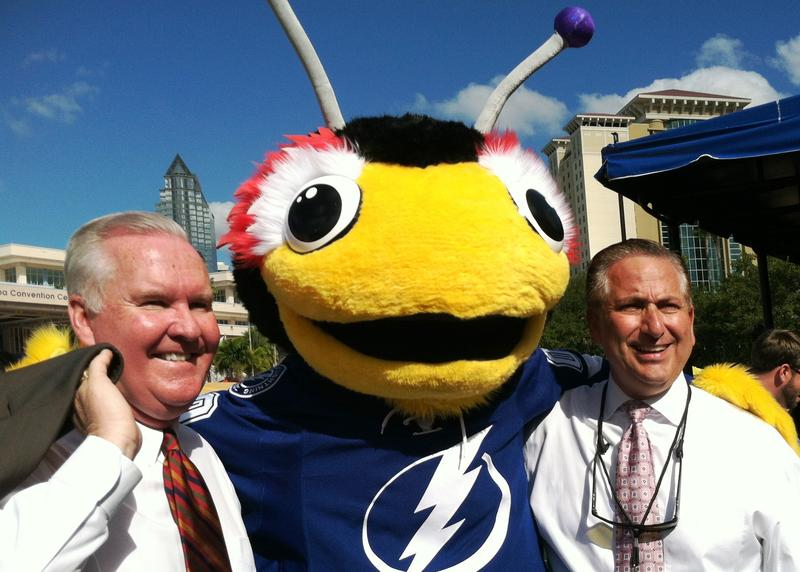 The Lightning ThunderBug poses with Tampa Mayor Bob Buckhorn and St. Petersburg Mayor Rick Kriseman.