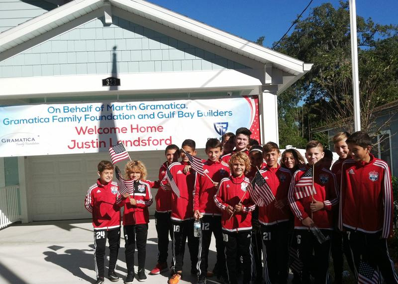 The youth soccer team, Tampa Bay United, that is coached by Martin Gramatica and helped with the veterans' house.