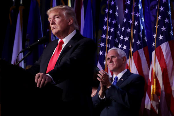 President-Elect Donald Trump delivers his acceptance speech as Vice President-Elect Mike Pence looks on during his election night event at the New York Hilton Midtown in the early hours of Wednesday morning.