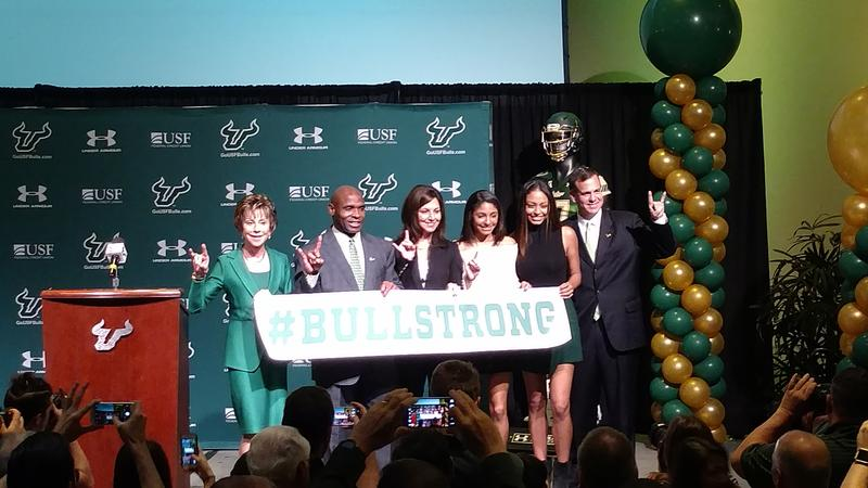 New USF football coach Charlie Strong (2nd from left) poses with USF System President Judy Genshaft (far left), his wife and daughters, and USF Athletic Director Mark Harlan at the USF Marshall Student Center Thursday.