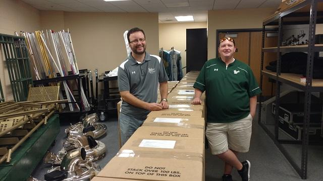USF Herd of Thunder Dir. Matthew McCutchen (left) and band office admin. Jason Bombaugh pose in early Dec. with some of the two tons of band gear being shipped off to Rome for the New Year's Parade.