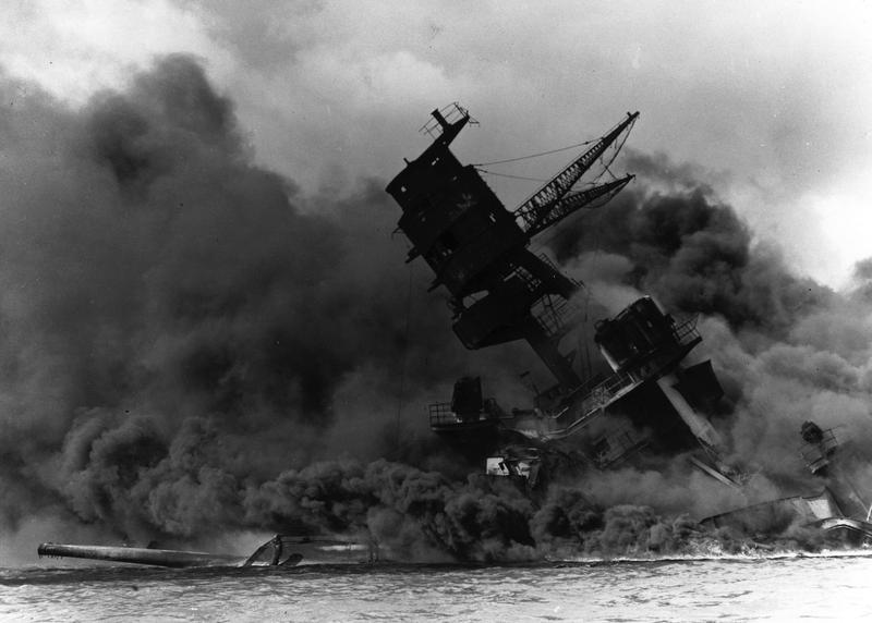 USS Arizona burns after her forward magazines have exploded. Note collapsed foremast.