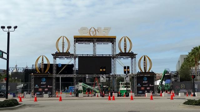 Construction crews prepare Tampa's Curtis Hixon Park earlier this week for the concerts taking place this weekend in conjunction with the College Football Playoff National Championship.