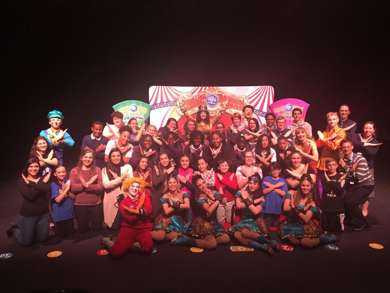 A group of performers with Ringling Bros. and Barnum and Bailey's Circus Xtreme poses with students at the Straz Center's Patel Conservatory in Downtown Tampa.