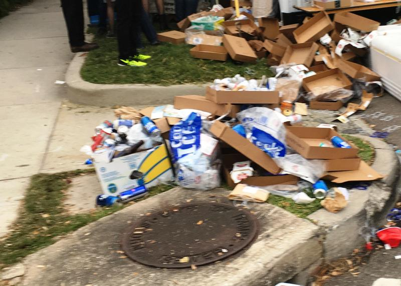 A corner filled with trash on the Gasparilla 2017 parade route.