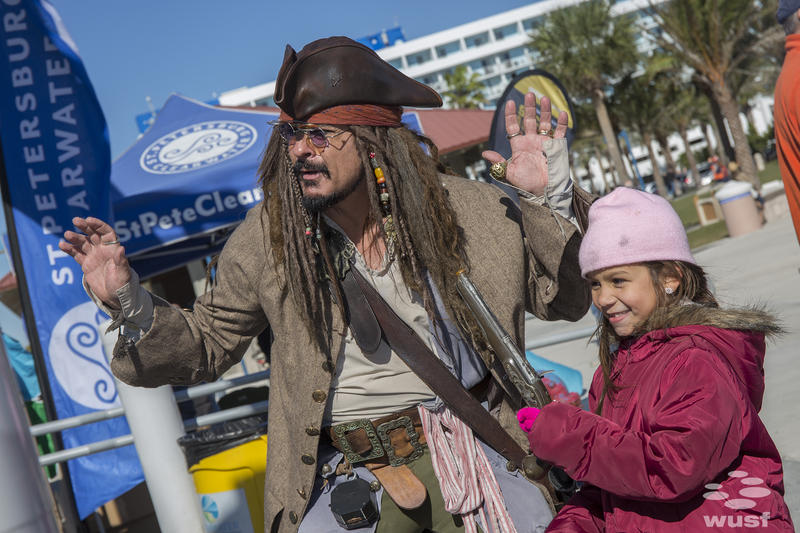 A cosplayer dressed as Captain Jack Sparrow engaged with fans at the Clearwater Beach Bash Party.