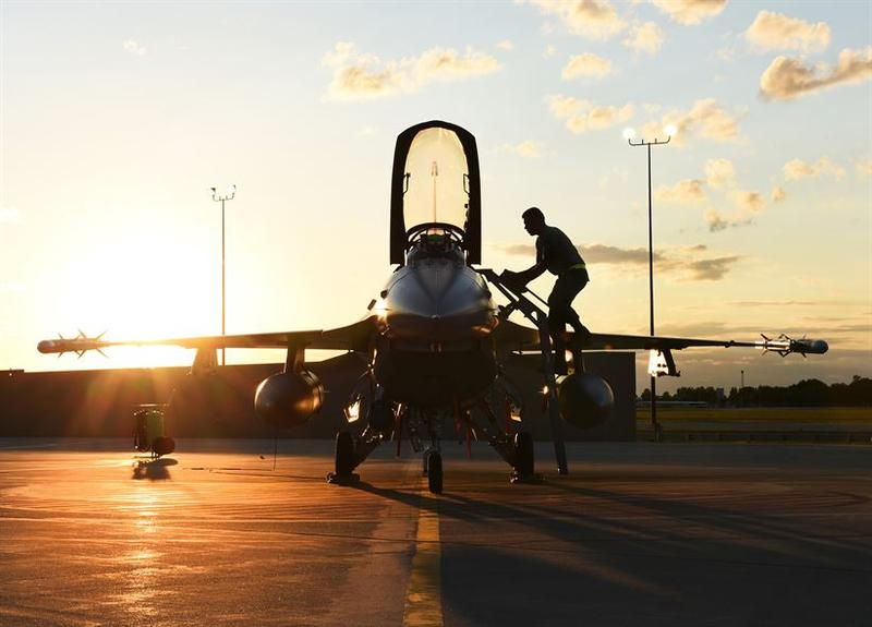 A crew chief assigned to the 180th Fighter Wing prepares an F-16 Fighting Falcon for night flying exercises Aug. 20, 2015. Night flying exercises help ensure that the Airmen of the 180th FW are highly trained and ready to deploy.