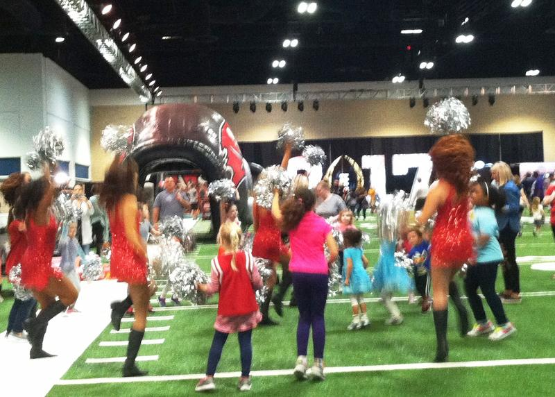 Buccaneer cheerleaders teach moves to children at the Fanfest 2017.