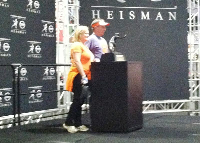 Posing with the Heisman Trophy - one of the fan experiences at the Championship Fanfest.