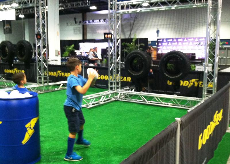 This football toss is one of many skill contests for children and adults to win prizes.