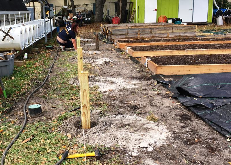 Construction of the fence that will define the Veterans' portion of the Sustainable Living Garden at 918 W. Sligh Ave., Tampa, FL.