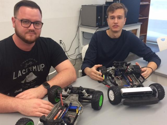 Jonathan Morris (left) and Max Cowan are students in the Autonomous Vehicles class at Florida Polytechnic University.
