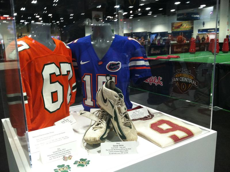 Throughout the Fanfest are cases with memorabilia from past college championship games.