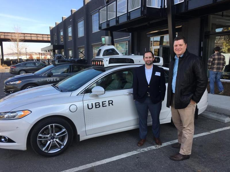 State Sen. Jeff Brandes (right) and one of his aides took a ride in one of Uber's self-driving cars. Uber is testing autonomous vehicle technology in Pittsburg. Currently, a human is still in the driver's seat to take over in an emergency.