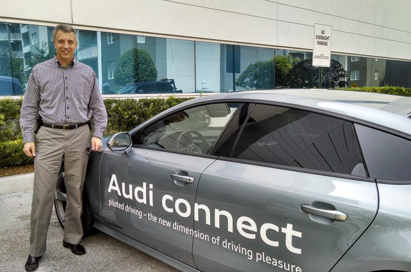 FDOT District Seven Secretary Paul Steinman is an active participant in the promotion of the automated vehicle effort. He's standing next to an Audi connected car. In 2014, Audi tested AV technology in Tampa on the Selmon Expressway's reversible lanes.