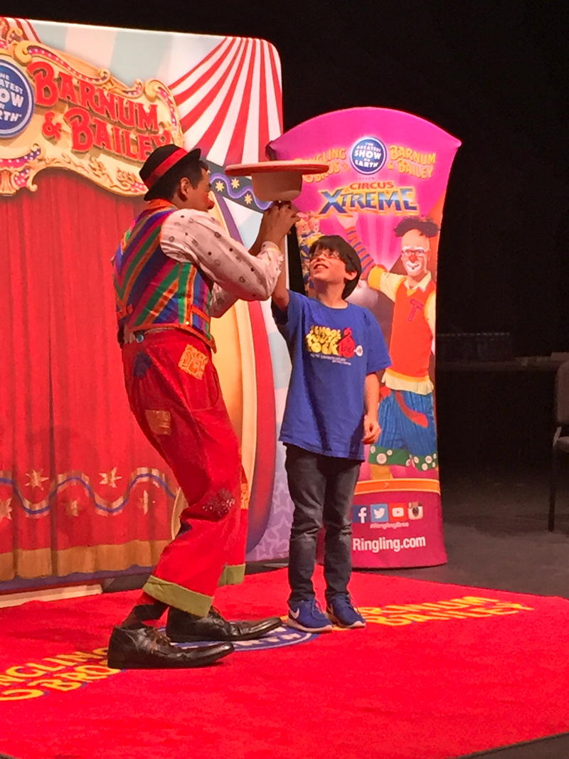Ivan Skinfill clowned around with the audience, inviting one boy up to twirl a bowler hat on his fingertip.