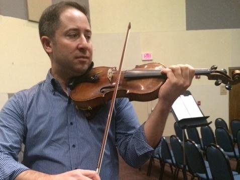 Daniel Jordan, concertmaster of the Sarasota Orchestra, with the Auschwitz violin