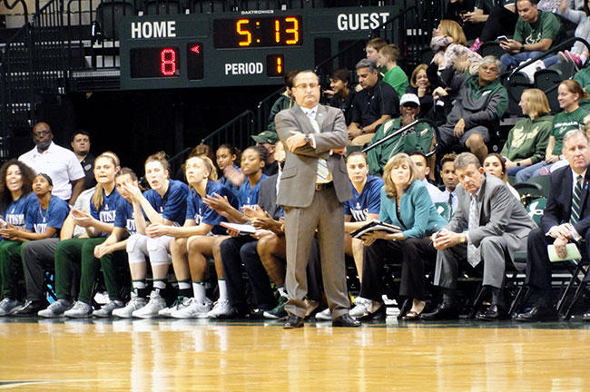 USF women's basketball coach Jose Fernandez stands on the sidelines during his team's 72-52 win over Cincinnati February 1 at the Sun Dome.