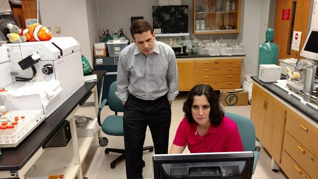 USFSP Neighborhood News Bureau director Bernardo Motta (left) and College of Marine Science research associate Dr. Kelly Quinn look over findings of tests for lead in the water from homes of Academy Prep students in St. Pete's Midtown neighborhood.