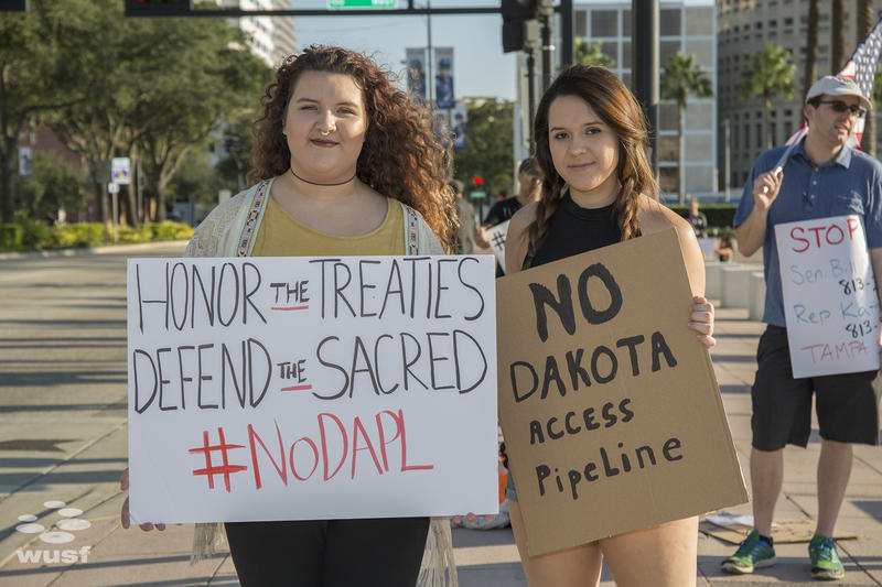 Mikayla Haak, left, is a member of Yankton Sioux Tribe, moved to Florida from South Dakota last year. She's protesting all pipelines.