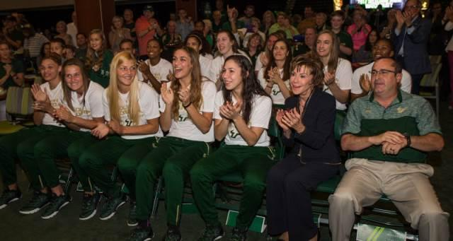 The USF women's basketball team, System President Judy Genshaft and head coach Jose Fernandez celebrate the team making the NCAA Tournament at a party at the Sun Dome Monday night.