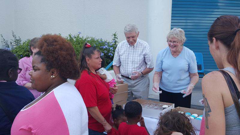 The Right Reverend Barry Howe and his wife Mary dole out cupcakes at Campbell Park Elementary School's recent neighborhood block party.
