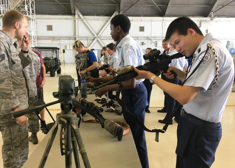 Junior ROTC cadets try out tactical gear set up at MacDill's STEM Day event.