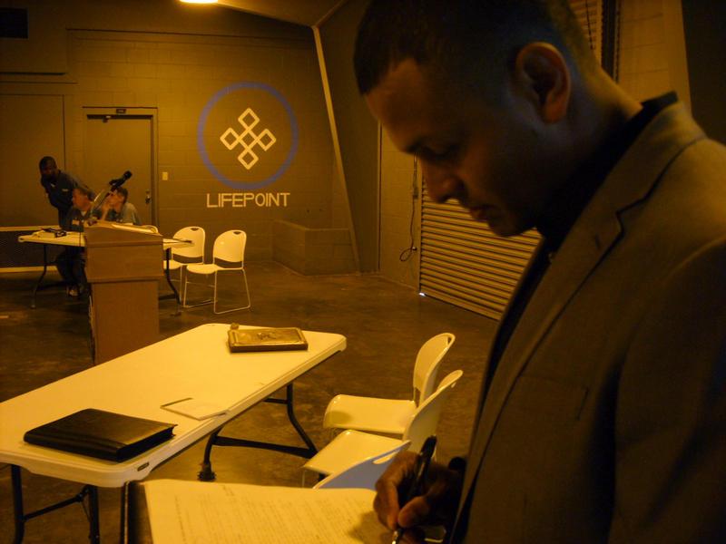 Senior Carlos Moreira makes last-minute preparations for the debate.