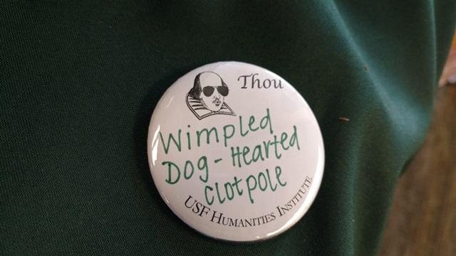 "The button Kicak created for me: ""Whimpled dog-hearted clotpole."" Listen to the University Beat radio report to find out exactly what a ""clotpole"" is."