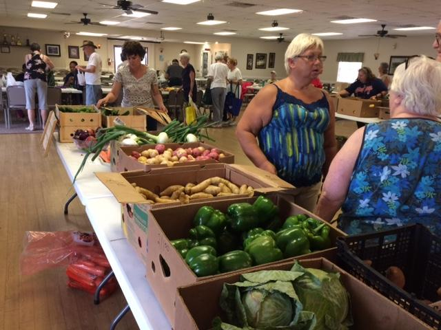 ElderPoint hosts a produce market co-op every Tuesday at the Woodbrook Estates Mobile Home community in Lakeland.