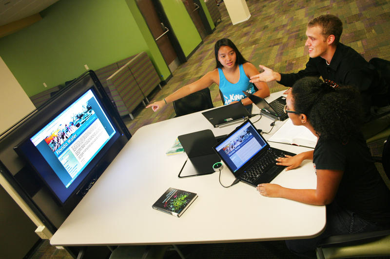 Three students studying in USF Tampa Library's Learning Commons